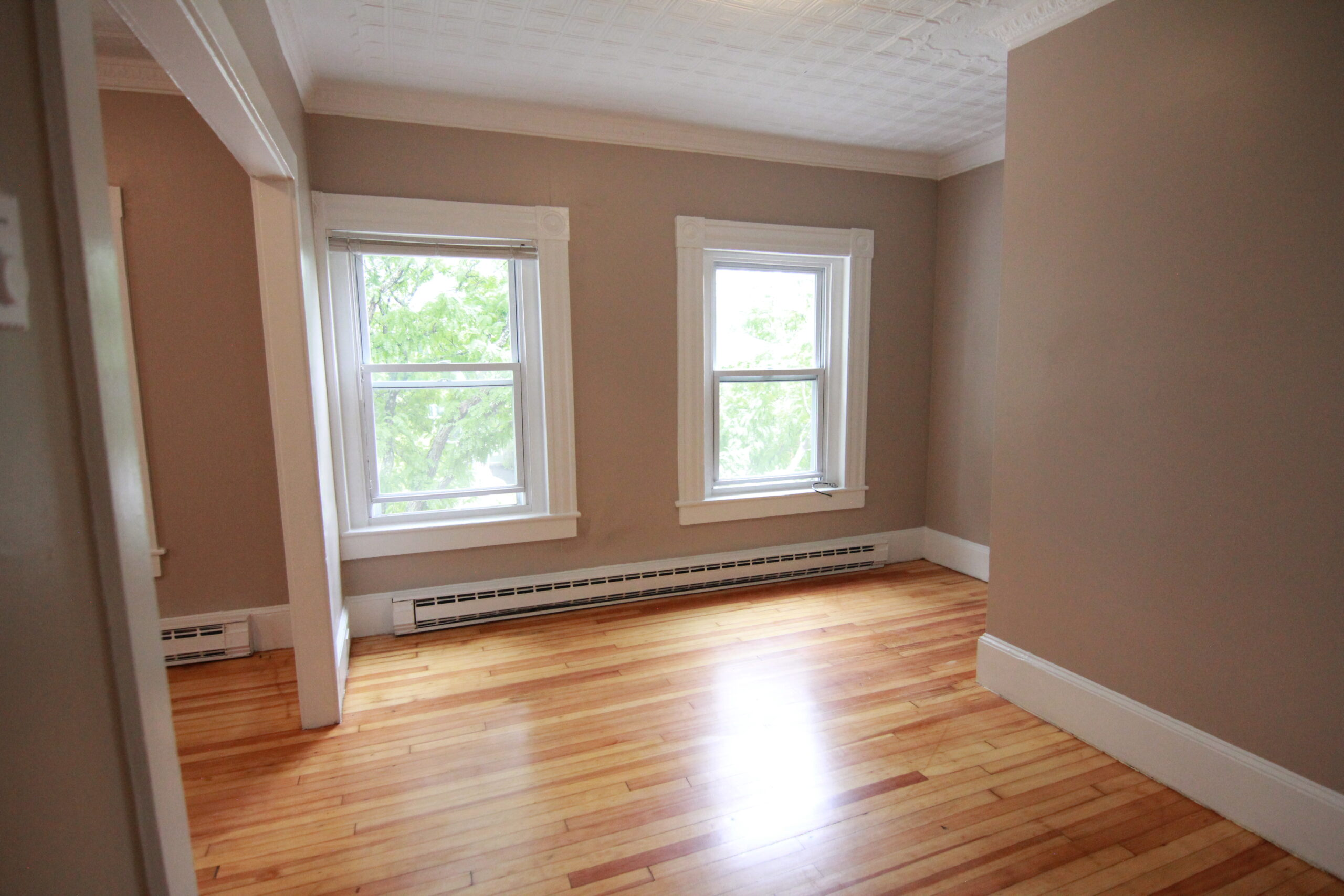 Baird Home Solutions - fresh paint molding and floors for this small apartment